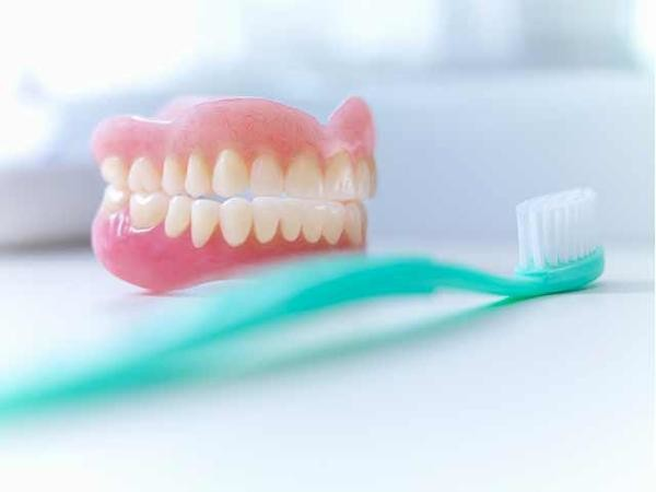 Brushing Your Teeth May Lower Dementia Risk (And 8 Other Reasons to Brush)